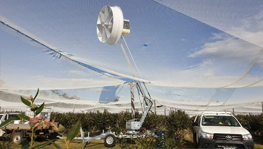 3.-Fans-can-be-used-under-netting-to-protect-crops,-fan-is-positioned-under-nets-and-then-boom-is-raised.